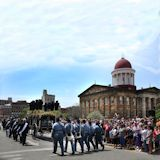 Eighth Veterans Reserve Corps follow behind the Lincoln hearse at the Old State Capitol
