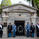 Pallbearers and members of the Veterans Reserve Corps stand at attention in front of the original receiving vault where Lincoln's casket was placed